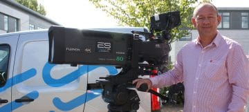 Warren Taggart, Managing Director of ES Broadcast Hire, with one of the company's current Fujinon UA80 lenses. The company has just bought Fujinon UA27 and UA107 lenses